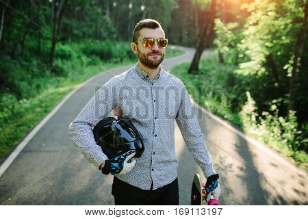 Skater Man Posing With His Longboard In Nature Park