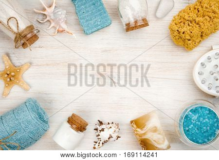 Spa and beach products on wood with copyspace in center