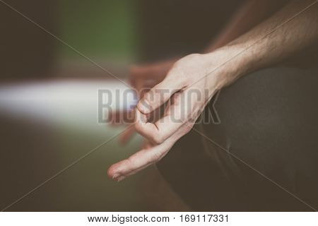closeup of man hand in yoga lotus position indoor healthy lifestyle concept