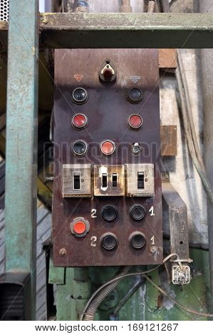 Industrial control panel in a retro style with buttons and toggle switch
