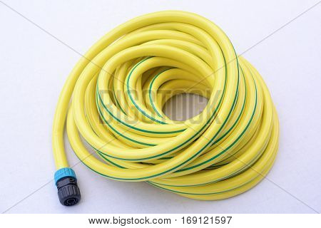 Garden hose-pipe wiht coupling on a white background