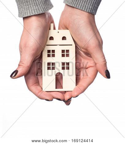 Architecture building real estate and property concept . Woman holding house or home maquette.