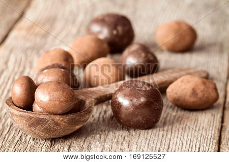 Sweet chocolate balls and small wooden spoon