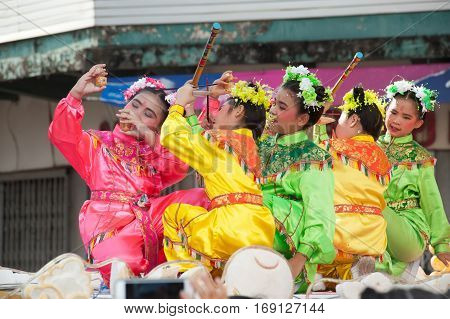 NAKORNSAWAN ,THAILAND - JANUARY 31,2017 : Unidentified young girls provide music for dance on the parade during Chinese New Year celebrations in Nakornsawan Province ,Middle of Thailand.