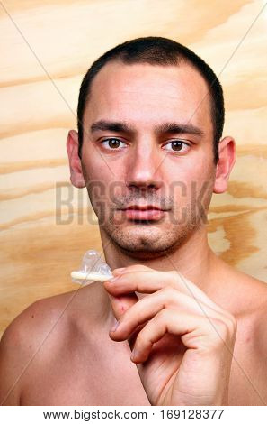 Young Handsome Boy And Condom