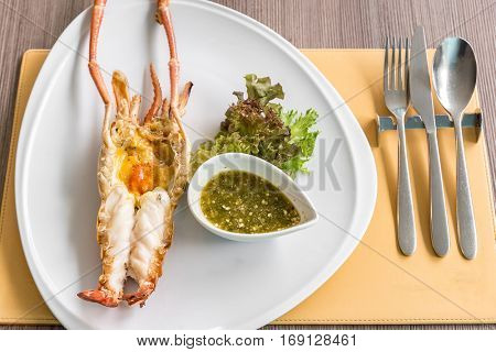 Grilled mighty tiger river prawn with spicy sauce and lettuce