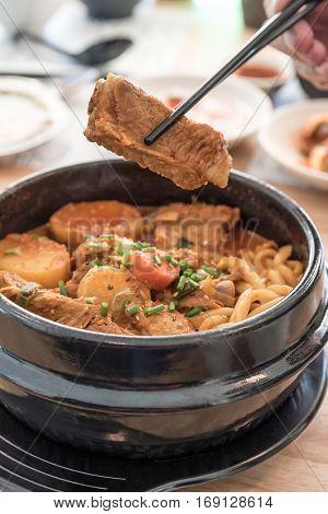 Gamjatang Korean Spicy Pork rib Soup with Kimchi and udon
