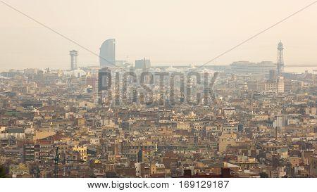 Smog over urban landscape of Barcelona Spain