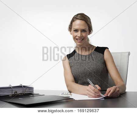 Business woman in office with pen and adminstration