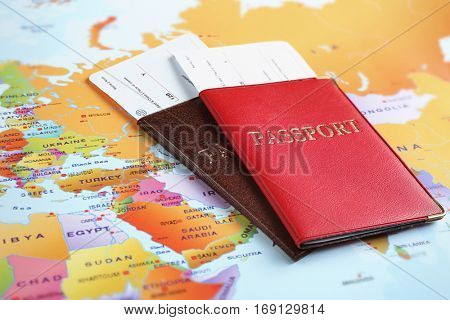 Adventure concept. Passports with tickets on map