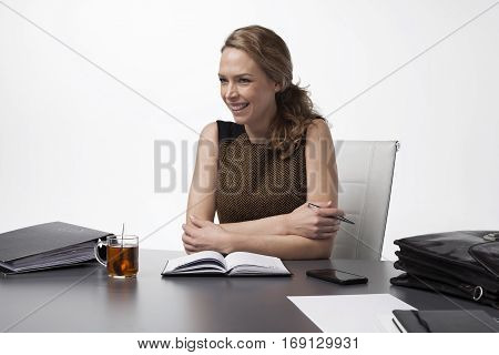 Young attractive and confident woman working in office