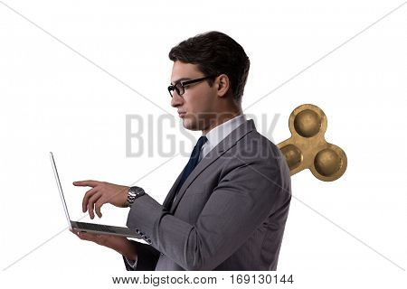 Businessman with key in hardworking concept