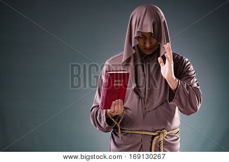 Monk in religious concept on gray background