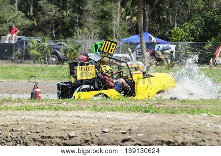 Naples Florida USA - March 3 2012: Swamp buggy powering through mudhole
