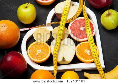 Diet, Fruits And Centimeter On A Black Background