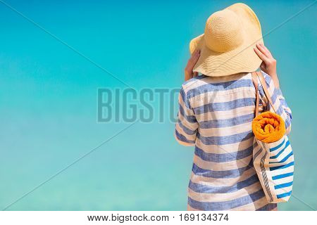 young woman enjoying summer vacation at perfect caribbean beach with turquoise water