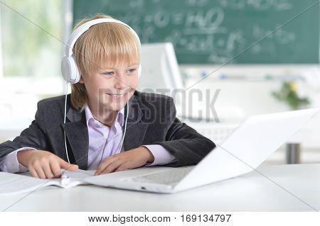 Portrait of a cute little boy using laptop