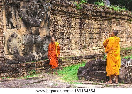 Preah Khan Temple, Buddist Monks Making Pictures.