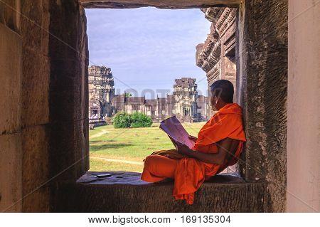 Angkor Wat, Cambodia - December 7, 2016: Monk Reading
