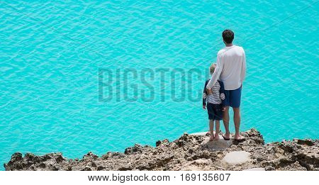 panorama of father and son enjoying beautiful anguilla island at caribbean