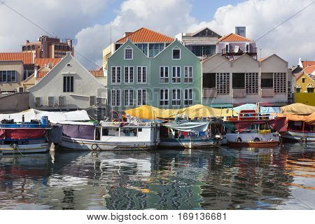 Colorful floating fruit market in Willemstad on Curacao