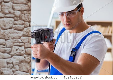Repairman working with drilling drill perforator