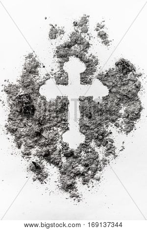 Christian orthodox crucifix sign made in grey ash dust dirt as a ash death religion ash wednesday symbol