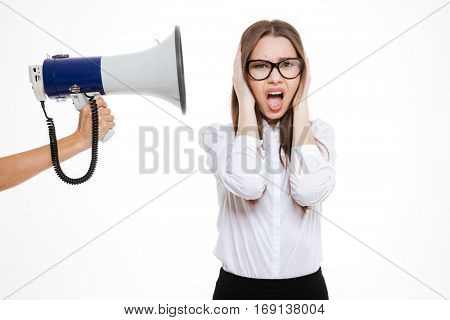 Boss with megaphone yelling at female colleague isolated on a white background