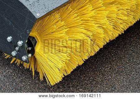 Yellow Brush of the Road Cleaner with electric drive.