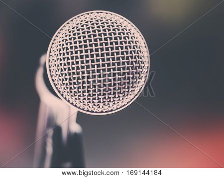 Retro color filter/ Close up of microphone in karaoke room or conference room. With place your text on background