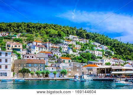 Seafront view at small mediterranean village on Island Brac, croatian travel places, Europe summertime.