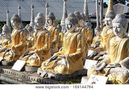 Rows of old stone statues of Buddha, Aung Setkya Paya, near to famous Bodhi Tataung temple complex, Monywa, Sagaing Region, Myanmar (Burma)