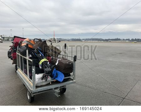 Luggage on a trailer at the airport