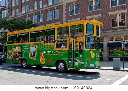 Boston, Massachusetts, US, 25 Jul. 2009: Boston Upper Deck Trolley Tours Bus in the street with AD of famous tourist attraction places