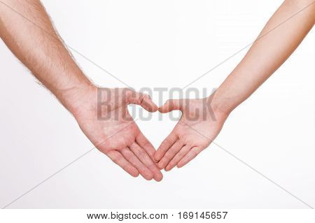 Couple close to each other and smiling making heart shape made with their fingers isolated on white background.