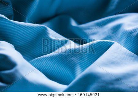 Soft morning light on a sleepy bed sheet wrinkle as a sleep background