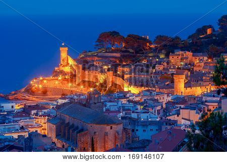 Night view of ancient fortress and Badia de Tossa bay in Tossa de Mar on Costa Brava, Catalunya, Spain.