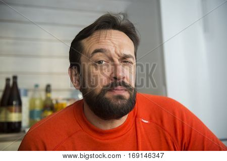 Middle-aged bearded man pensive portrait.