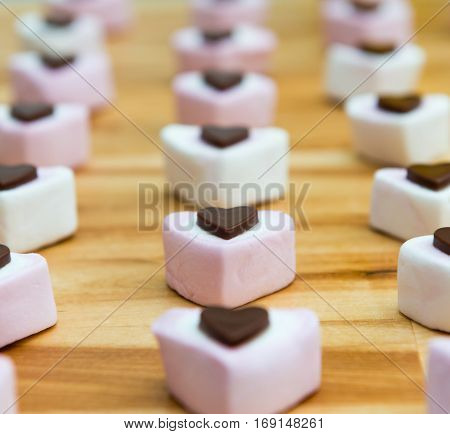 Rows Of Heart Shaped Marshmallow And Chocolate Sweets.