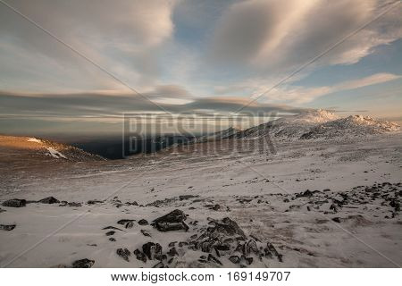 winter hiking: a mountain range under the beautiful clouds in the blue sky. Northern Urals