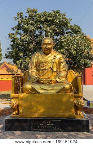 Lumbini, NEPAL - November 17, 2016: Ben Huan. Chinese monk statue near the Chinese temple, Lumbini, Nepal.
