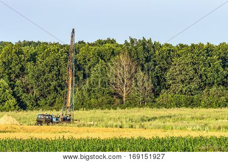 Car with a drilling derrick for geological survey on the land