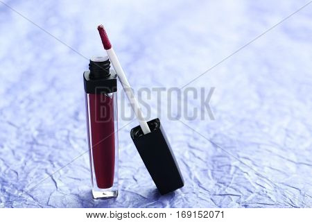 Colorful Lip Gloss On Blue Paper Background