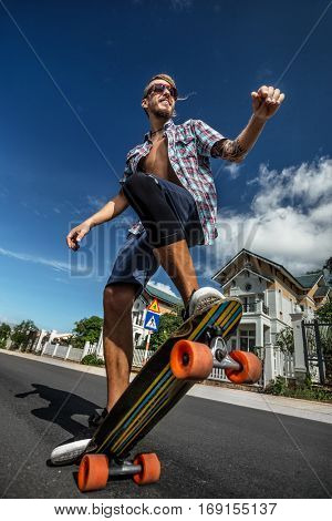 Skating man riding on a skateboard