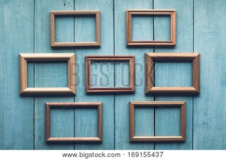 old wooden frames on old blue wall.