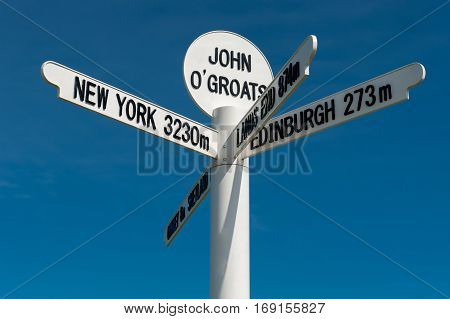 The milepost sign at John O Groats in Scotland on the most north eastern tip of the UK