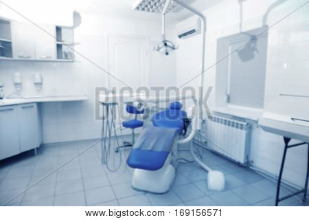 Professional tools and chair in modern dentist room