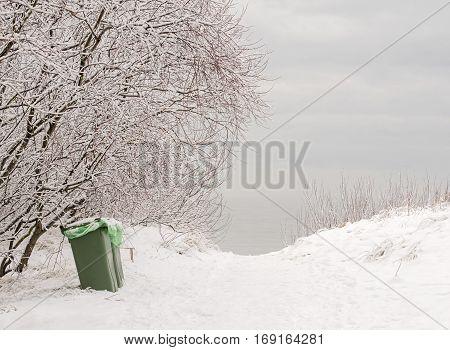 Plastic bins for rubbish near the sea in winter