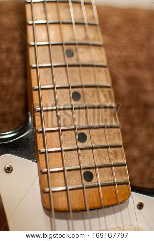 Vintage Fender electric guitar maple neck close up