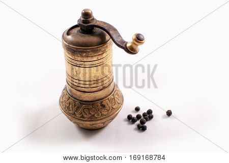 Vintage brass Turkish pepper mill on white background